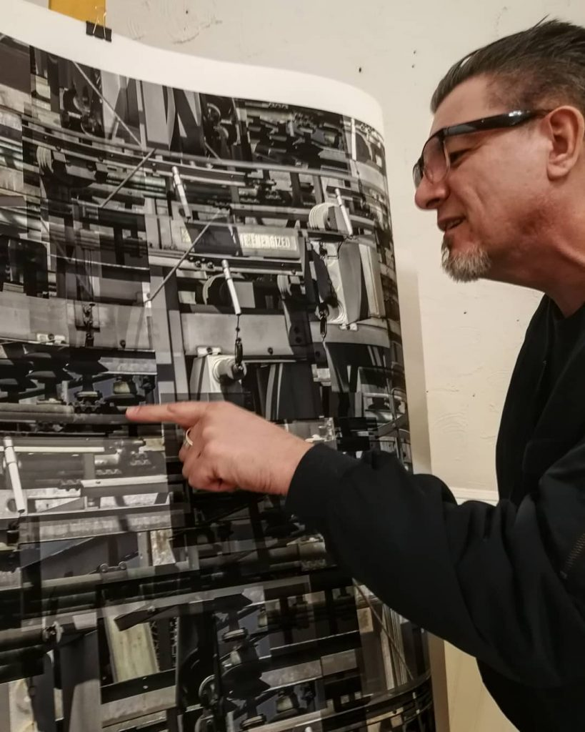 Kent Lins proofing a large print
